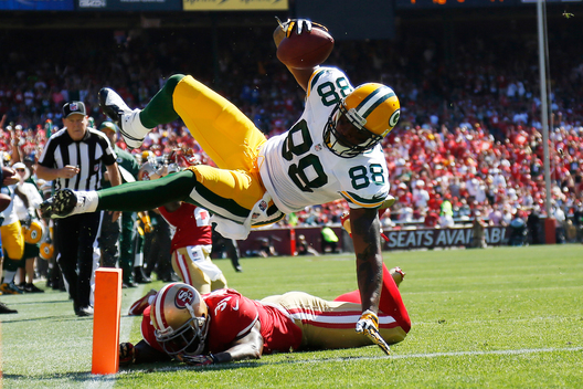 Green Bay Packers tight end Jermichael Finley (88) leaps for a touchdown during the second quarter of his NFL season home opener football game against the San Francisco 49ers in San Francisco, California September 8, 2013.