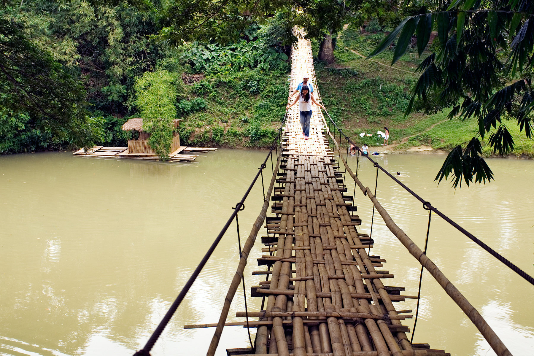 "Philippines, Bohol, Tigbao Hanging Bridge, Loboc River, Visayas. This bridge was named one of the ""13 most spectacular footbridges in the world"" by CNN."
