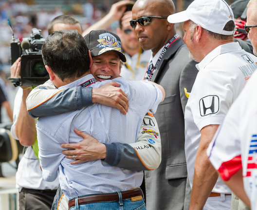 Indianapolis, IN - May 29: Dan Wheldon receives a hug after winning the 2011 Indianapolis 500 Mile Race on May 29, 2011 at Indianapolis Motor Speedway in Indianapolis, Indiana.