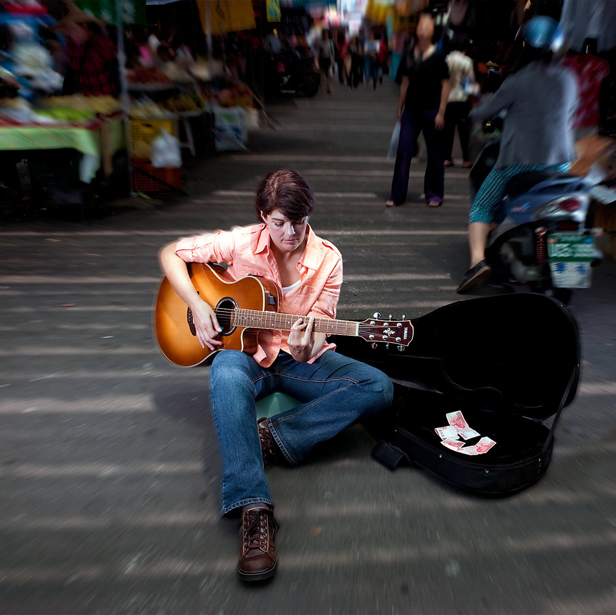Busking in a far away land.  Travel, music, entertaining, making money- life is great!