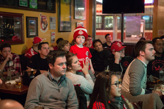"Three year-old Henry Doyle, who attended his first ever TFC game at the ripe young age of 21 days, watches the first leg of the MLSE semi-finals against Montreal with his parents. ""Now when he misses a game he's devastated,"" explained his mother Michelle. Michelle and her husband Dylan were two of the founding members of Kings In The North, one of the team's several supporters groups.