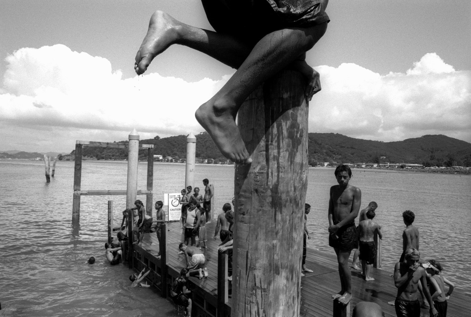 Maori youth swim near the Waitangi treaty grounds.  There is currently a renaissance of traditional Maori culture in New Zealand.  Maori children are taught their language and customs by elders. The connection to the land is very strong in Maori culture.