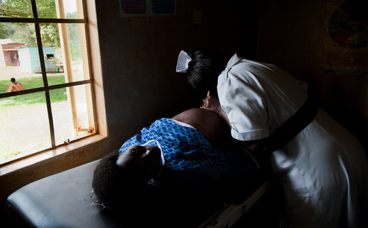 An expectant mother at her prenatal checkup in Mukono, Uganda.
