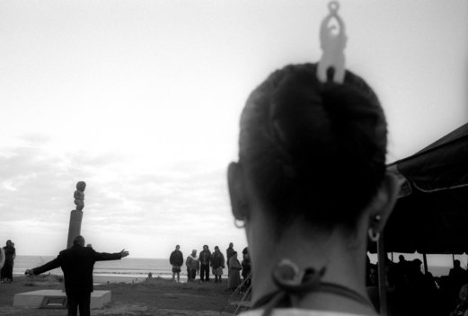 ©Tamara Voninski. Maori people gather at Ahipara Beach , the southern end of Ninety Mile Beach, in New Zealand to dedicate a pouwhenua (marker pole).  The Pouwhenua symbolizes the long-standing relationship that the Maori people have with land including the adjoining foreshore and seabed.  The ceremony marks traditional ownership rights of the Maori people.  In Maori legend, the spirits of the dead depart the earth along this beach.  In 2005, the New Zealand government passed the controversial Seabed and Foreshore legislation to prevent Maori from claiming exclusive ownership of New Zealand2019s resource rich coastline and seabed. The Maori traditionally see themselves as caretakers of the land and coastline.  The Maori population is approximately 530,000 of four million New Zealanders.