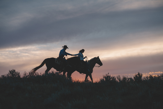 Horseback riding for thier engagement shoot. The cowboy way