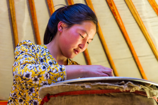 This beautiful Mongolian girl taught us the age-old distilling process of yak vodka.