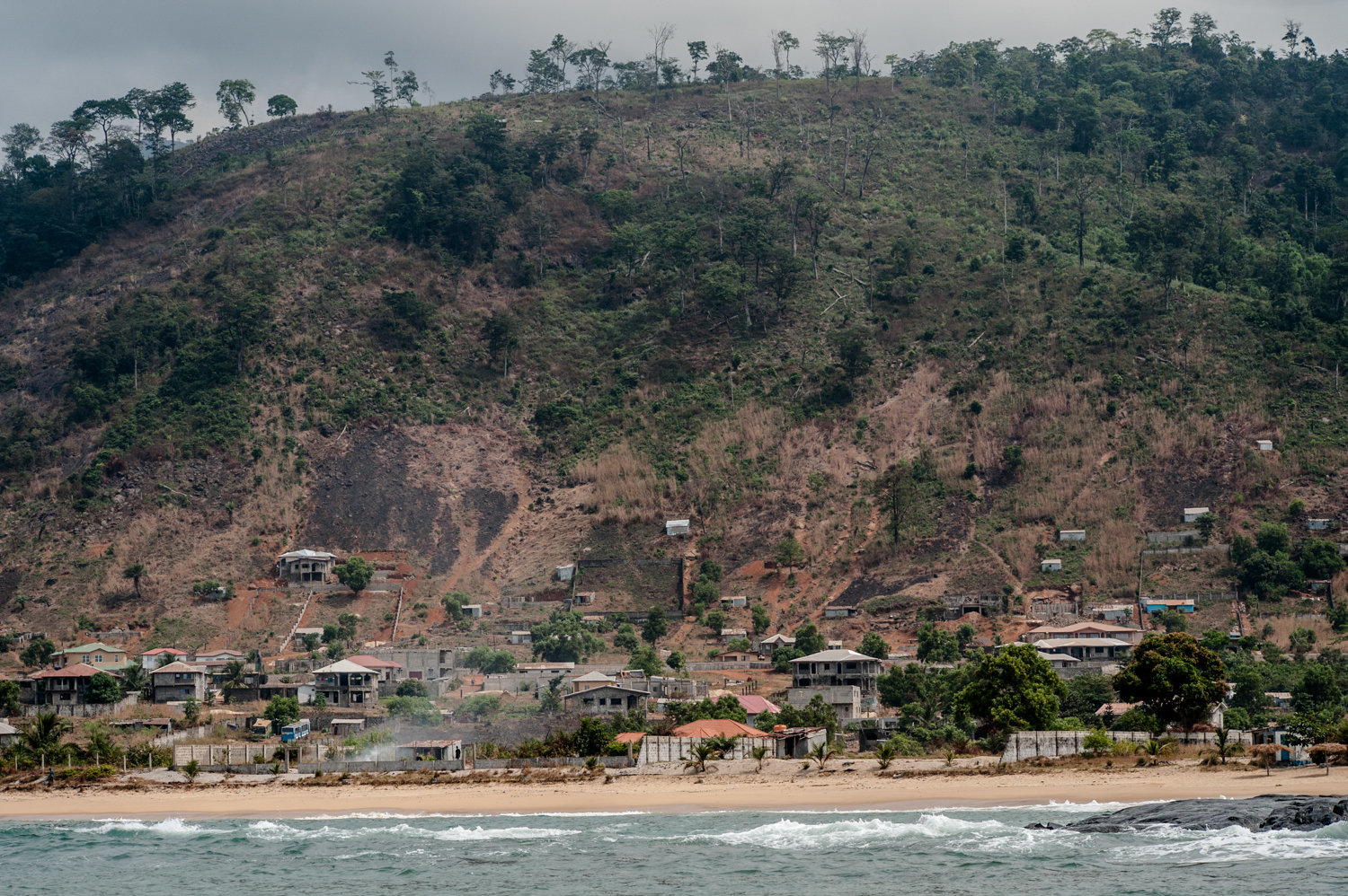 Further north and closer to the capital city of Freetown, the results of illegal sand mining and deforestation are evident.  The area's natural resources are being ravaged to make way for a new road.