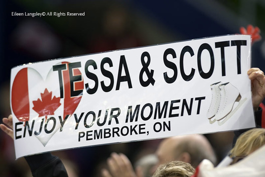 Spectators at the Figure Skating event hold up a message of support for Canadian ice dancers Tessa Virtue and Scott Moir at the 2010 Winter Olympic Games in Vancouver