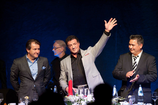 MACLEANS-STALLONE-02.23.12-HAMILTON, ONTARIO: Sylvester Stallone waves as a gesture to a crowds applause during a Canadian Diabetes Association fundraising dinner and auction at Carmen's in Hamilton, Ontario.