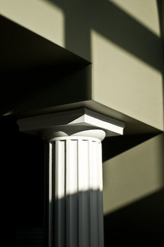 An architectural column caputured with natural light and an interesting pattern of shadows and sunlight