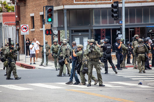 Demonstrators angered over the death of George Floyd at the hands of police in Minneapolis face off against Police officers in riot gear and SWAT teams at the corner of Main Street and Hill in Santa Monica, California.