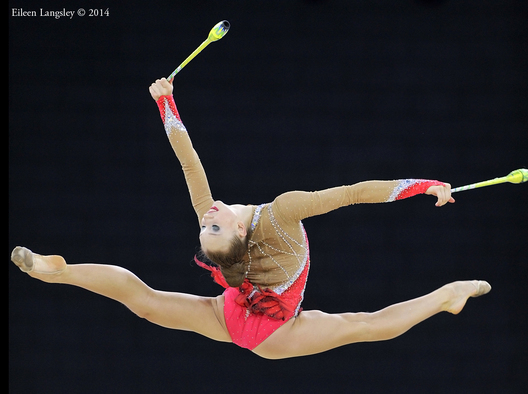 Patricia Bessoubenko (Canada) competing with clubs during the rhythmic gymnastics competition at the 2014 Glasgow Commonwealth Games.