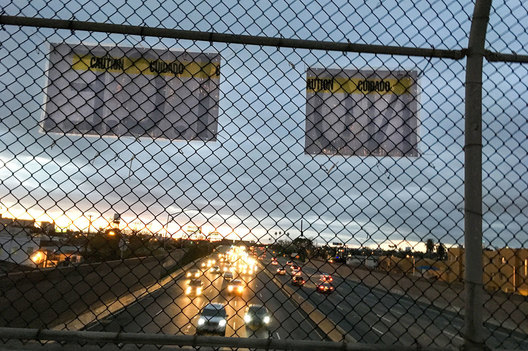 A sign posted above the I-5 freeway heading into Maywood declares local opposition to I.C.E, (Immigration and Customs Enforcement).