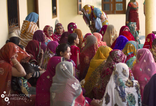 Rajasthani women wait for bride and groom destination wedding india Kathryn Cooper Weddings