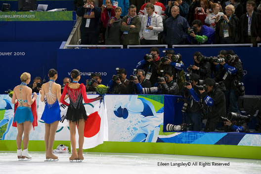 The medak winners from the Ladies Figure Skating event pose for photographers at the 2010 Vancouver Winter Olympic Games.