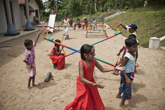 Children play on the playground built for the new community center and school outside of Hikkuduwa.  The community center and school were built after the 2004 tsunami.