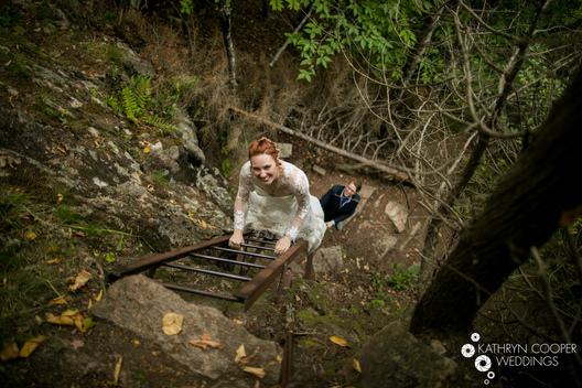 Acadia National Park wedding - two brides climb ladders on steep hiking path