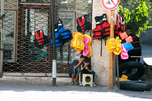 Children selling lifejackets on the streets of Izmir. At the height of the refugee crisis, the Turkish port became one of the main points of departure for those seeking to make the crossing by sea to the Greek island of Lesbos. There were people selling lifejackets on almost every street corner in the central district of Basmane. Many shops - and restaurants - converted themselves into lifejacket vendors to capitalize on the influx of refugees.