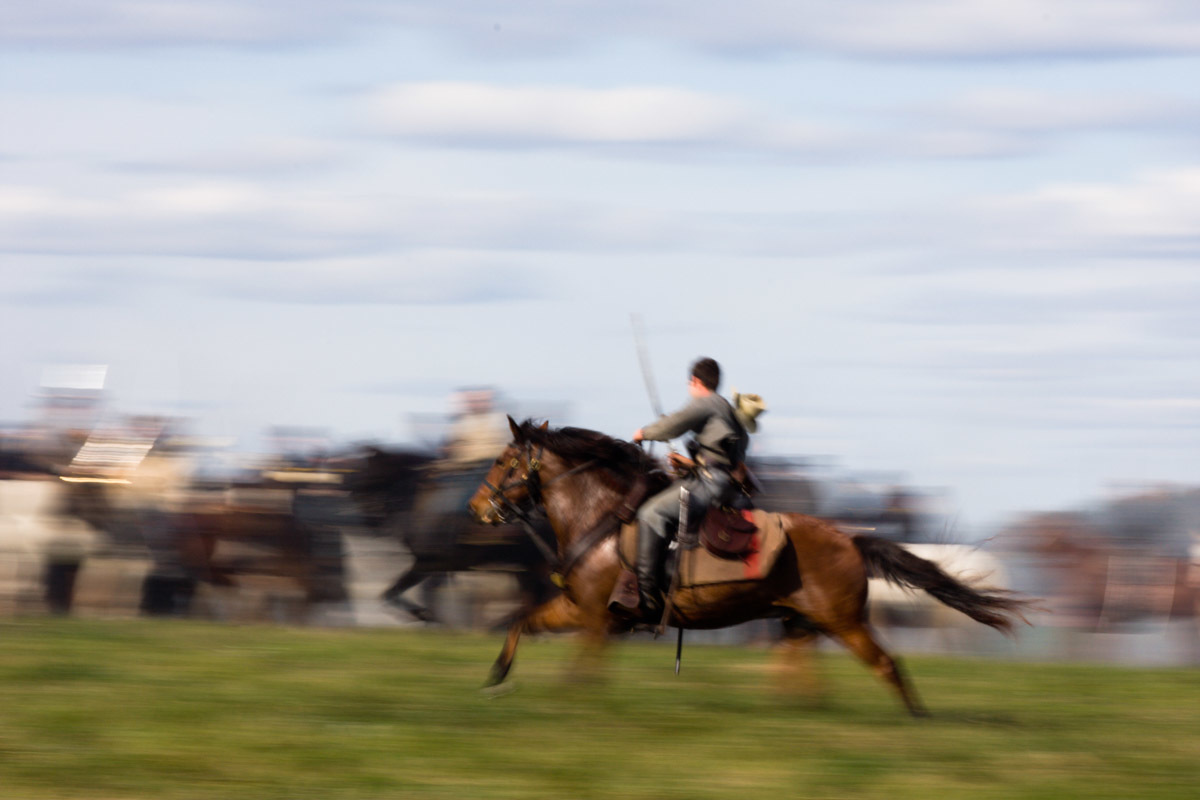 A Civil War Battle Renactor races his horse across the field at the renactment of the Battle of Berryville.  The Battle of Berryville took place 1/2 mile east of Berryville, Virginia on September 3-4, 1864 between Federal soldiers led by General Sheridan and Confederate soldiers led by General Kershaw. Leading 2400 soldiers, the Federals were strongly outnumbered, pitted against General Kershaw's division of 3,500. Federal casualties were more than double Confederate casualties.