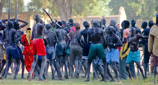 "Every Dinka male is a warrior. At Freedom Square in Rumbek, South Sudan, young men group together at an annual gathering to select a new song for their warrior ""age-set."""