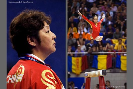 A seemingly inscrutable Chinese head coach watches her gymnast, Deng Linlin competing on the Balance Beam at the 2009 London World Artistic Gymnastics Championships at the 02 Arena.