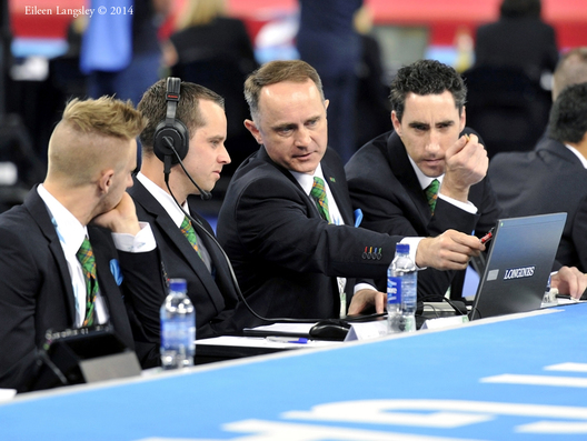 A group of judges in the men's artistic gymnastics competition at the 2014 Glasgow Commonwealth Games.