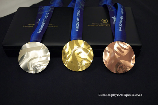 The Gold Silver and Bronze medals awarded at the 2010 Vancouver Winter Olympic Games.