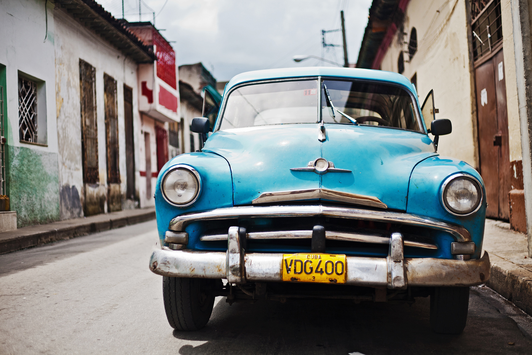 Old American blue car in the street of Santa Clara, Cuba