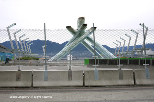 The Olympic Flame is extinguished and the cauldron still protected by fencing the day after the 2010 Winter Olympic Games end in Vancouver.