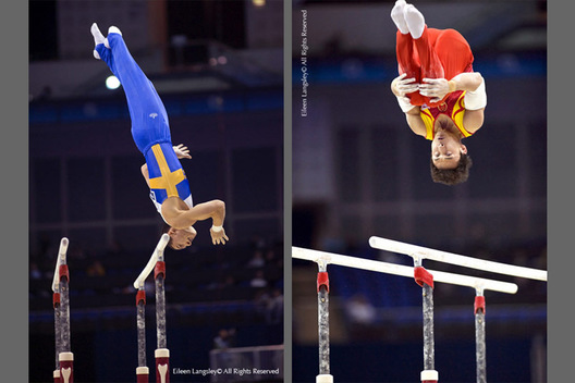 George Foo (Sweden) left and Feng Zhe (China) right perform difficult dismounts while competing on Parallel Bars at the 2009 London World Artistic Gymnastics Championships.