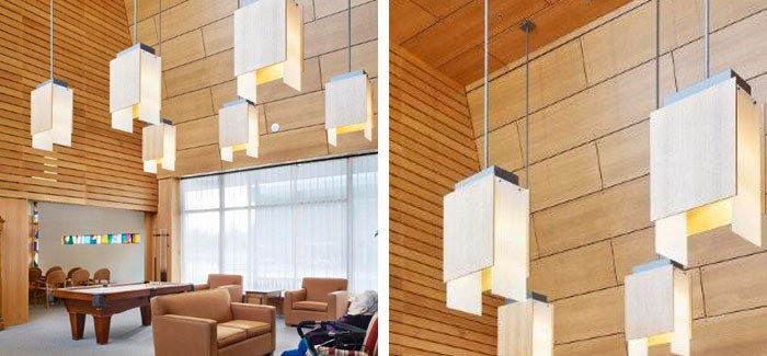 Veneer plywood, acrylic and painted steel bespoke retirement home great room pendants