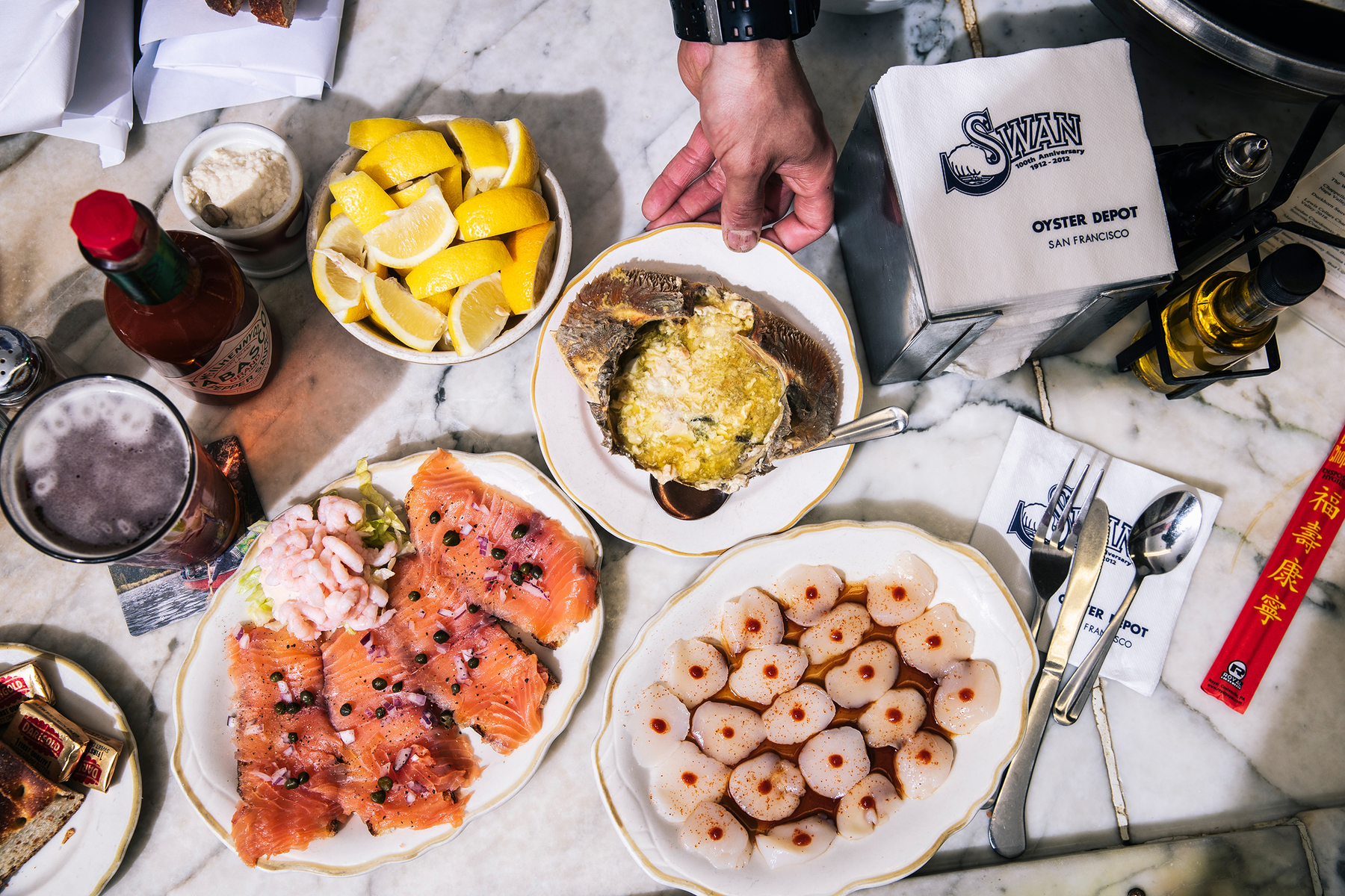 Smoked salmon toast, crab back and a Dozen Eggs pictured at Swan Oyster Depot in San Francisco, Calif. on Tuesday, April 2, 2019.