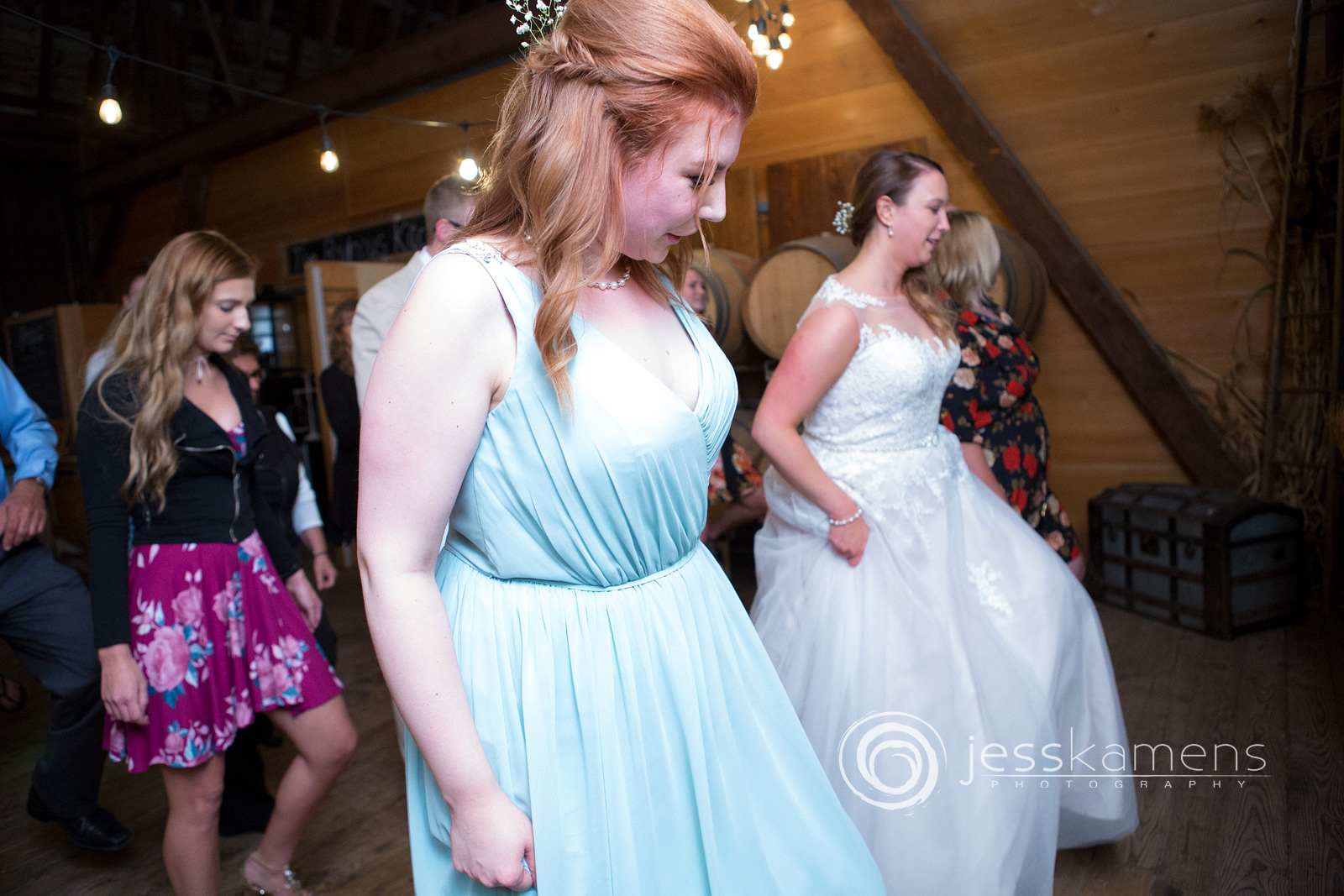 bride and maid of honor dance at the wedding