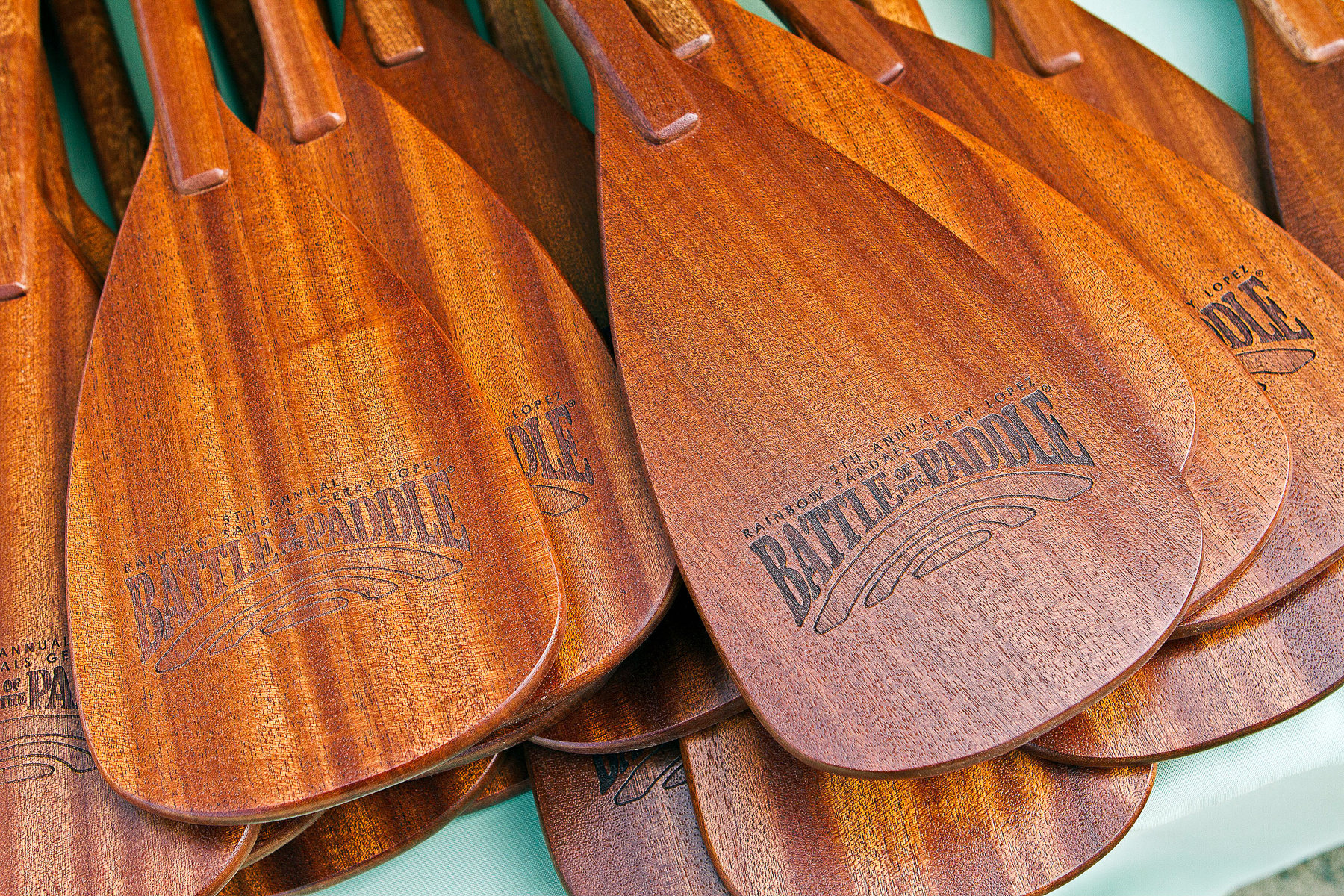 Dana Point, CA - September 30: Wooden paddle awards grace a table during the Battle of the Paddle, on September 30, 2012 at Doheny Beach in Dana Point, California.