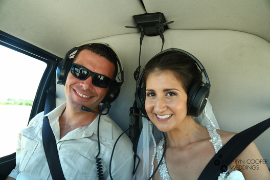 Couple getting married on helicopter photographer kathryn cooper weddings St. Thomas usvi