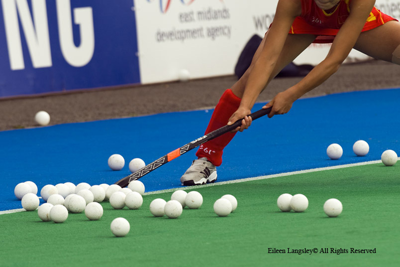 A cropped generic action image of a Chinese player practising taking penalty strokes before their match against Argentina at the 2010 Women's World Cup Hockey Tournament.