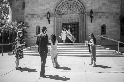 Strange Days; Life Under Covid-19. A wedding at St. Monica's Catholic Church attempts to create a sense of normalcy in daily life, despite being limited to a very small group of attendees.
