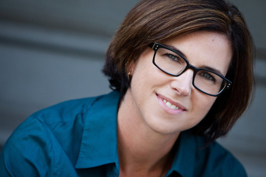 Business headshot of Caucasian brunette woman wearing glasses by commercial photographer Nancy Rothstein