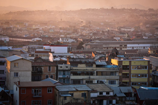 A view overlooking the bustling polluted capital city of Antananarivo, Madagascar during sunset.  At around 1400 meters above sea level, with a population of 1.2 million, Tana can be quite chaotic and especially chilly during the winter months.