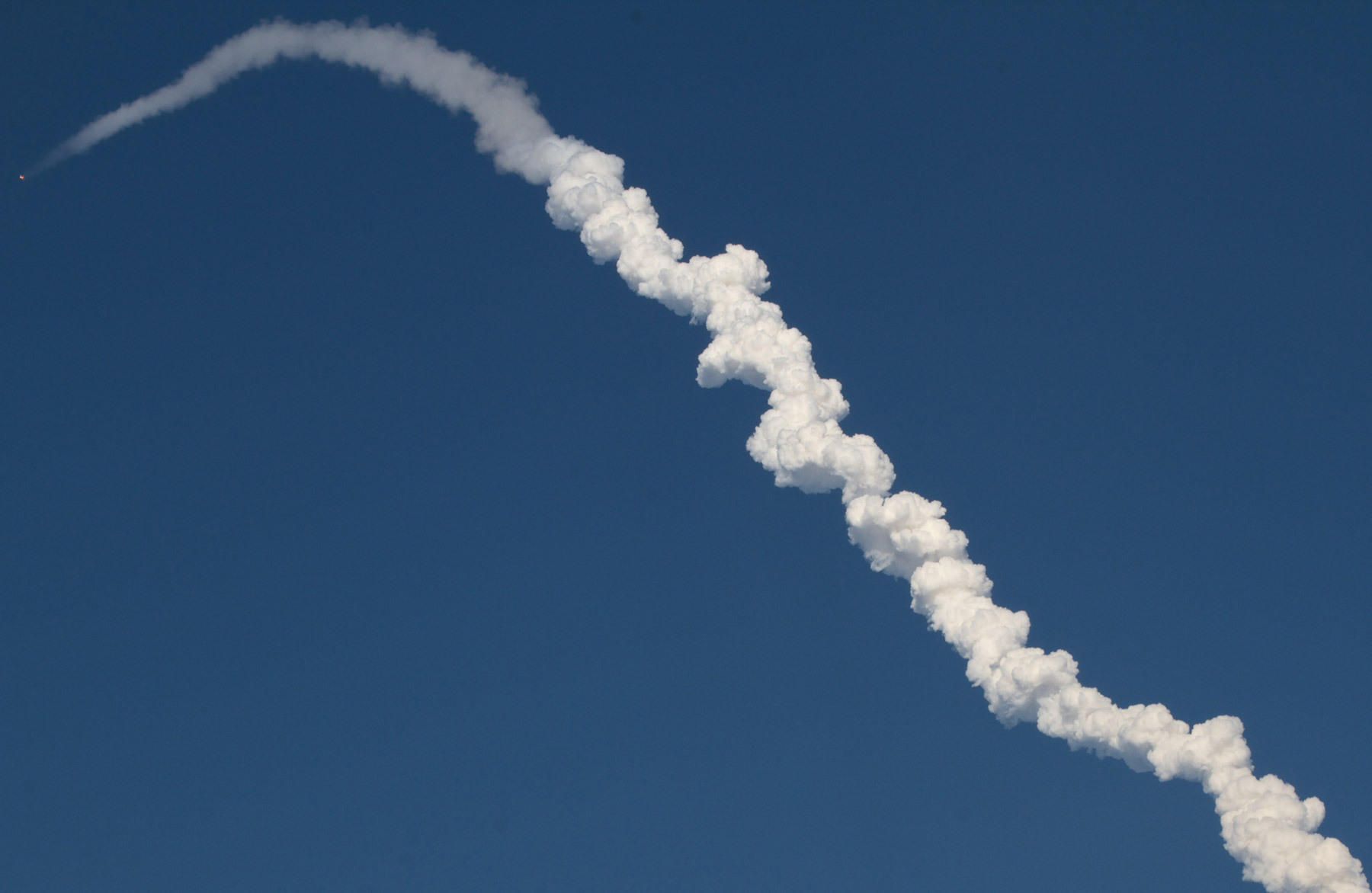 Note: That little orange dot at the top of the rocket's plume is the space capsule containing two astronauts