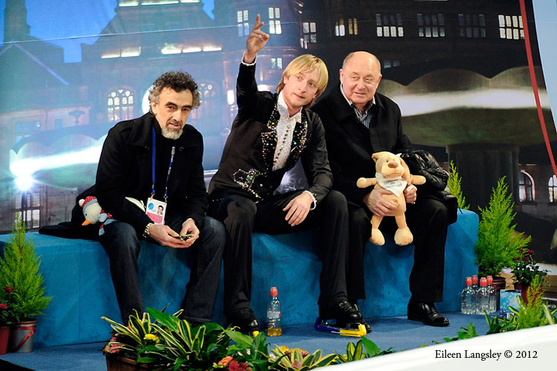 Evgeni Plushenko and his coaches wait for his score in the 'kiss and cry' area at the 2012 European Figure Skating Championships at the Motorpoint Arena in Sheffield UK January 23rd to 29th.