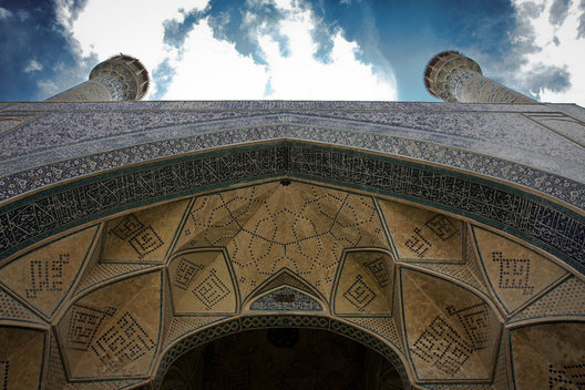 An impressive view of the massive arches of the Jameh Mosque in Esfahan, Iran.