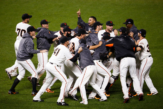 The San Francisco Giants celebrate after defeating the St. Louis Cardinals to advance to the World Series after Game 7 in their MLB NLCS playoff baseball series in San Francisco, October 22, 2012.