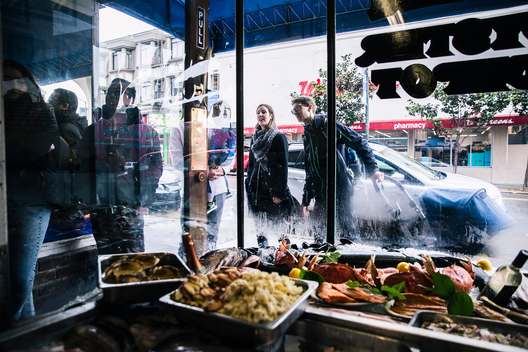 People wait to be seated outside Swan Oyster Depot in San Francisco, Calif. on Tuesday, April 2, 2019.