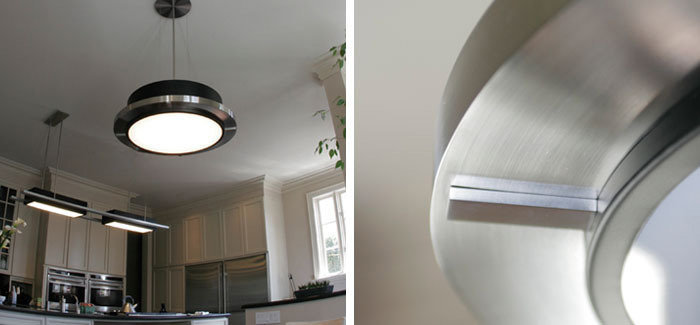 Brushed stainless steel linear custom island pendant and matching round kitchen table pendant