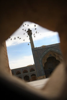 View through an opening in Iran's largest mosque, Jameh Mosque in Esfahan, dating back 800 years.