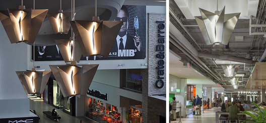 "Folded stainless steel sheet ""origami"" LED single pendants with integral drivers. Escalator feature pendants visually lead customers from mall level to 3rd floor food court"