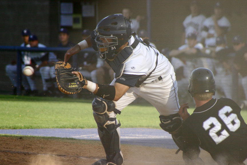 Bubba Ruddy, catcher for the Cypress College baseball team, prepares to catch the ball in an effort to tag out Riverside Community Colleges Robert Burk across home plate in the 10th inning during a game March 29 at Cypress. Although Burk was safe and his run put Riverside ahead in the extra inning, Cypress hit in two more and won the game 7-6.