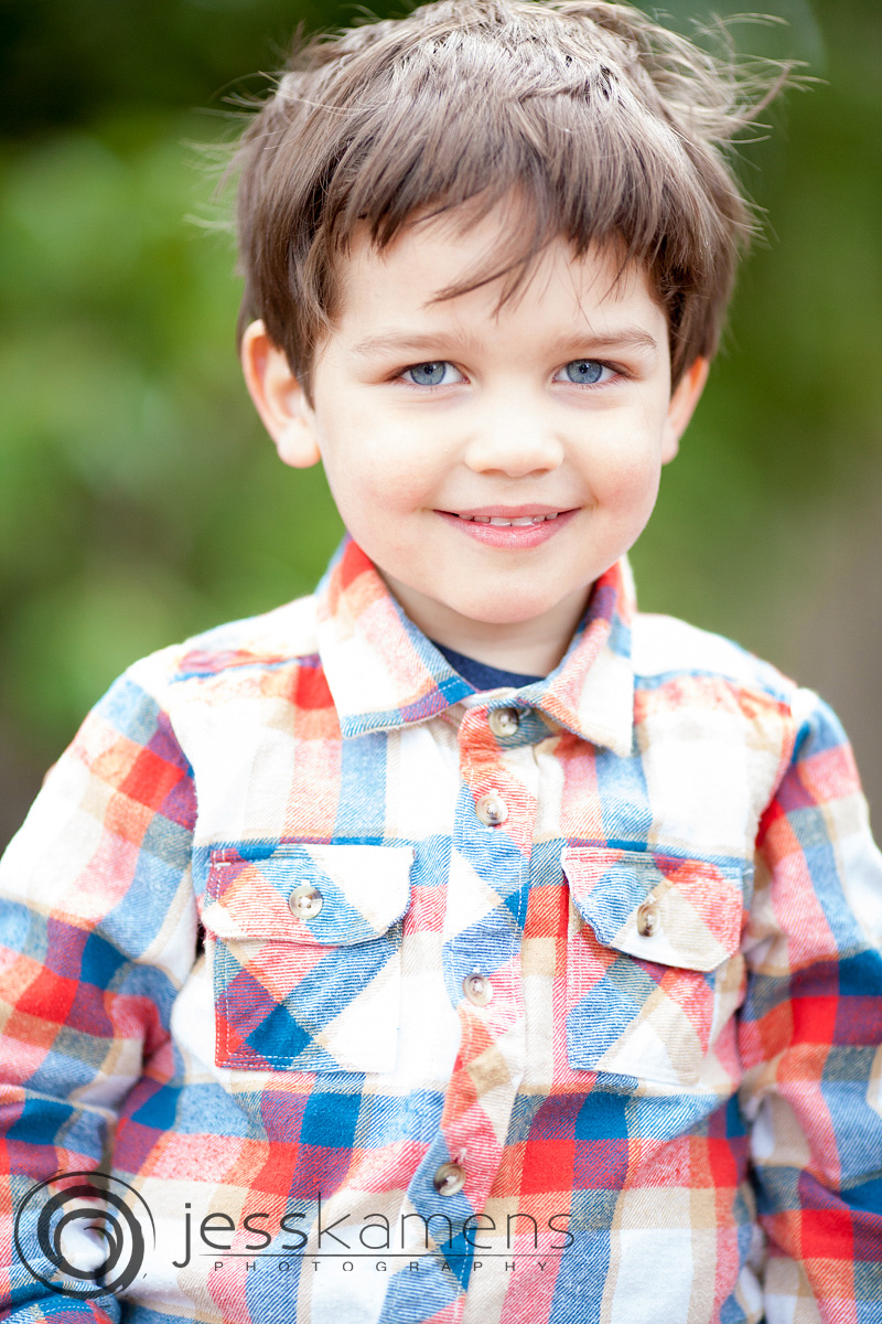 boy in a shirt smiling at the camera for his school picture