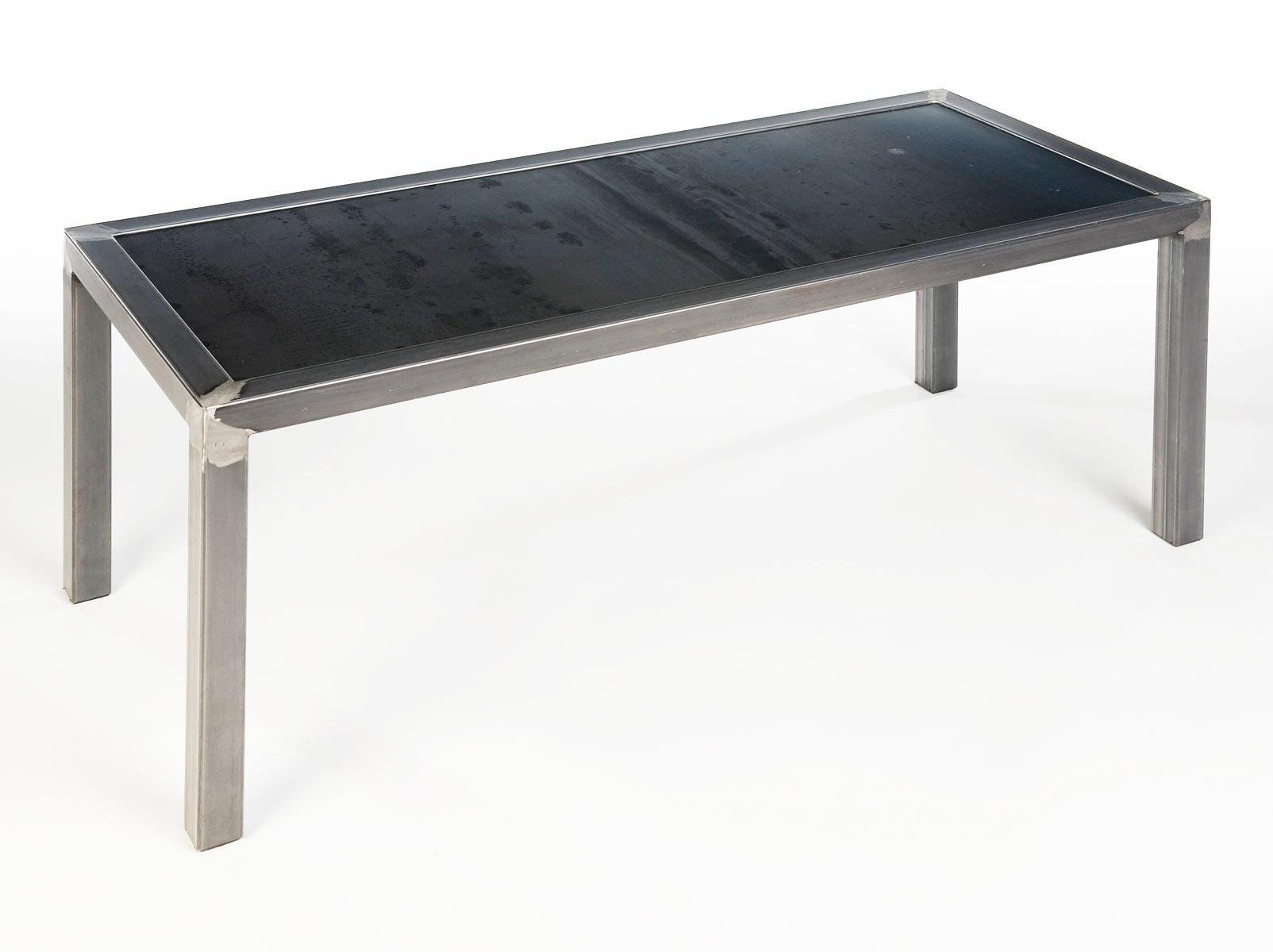 Bench made from waxed steel tube frame and 11 guage steel plate